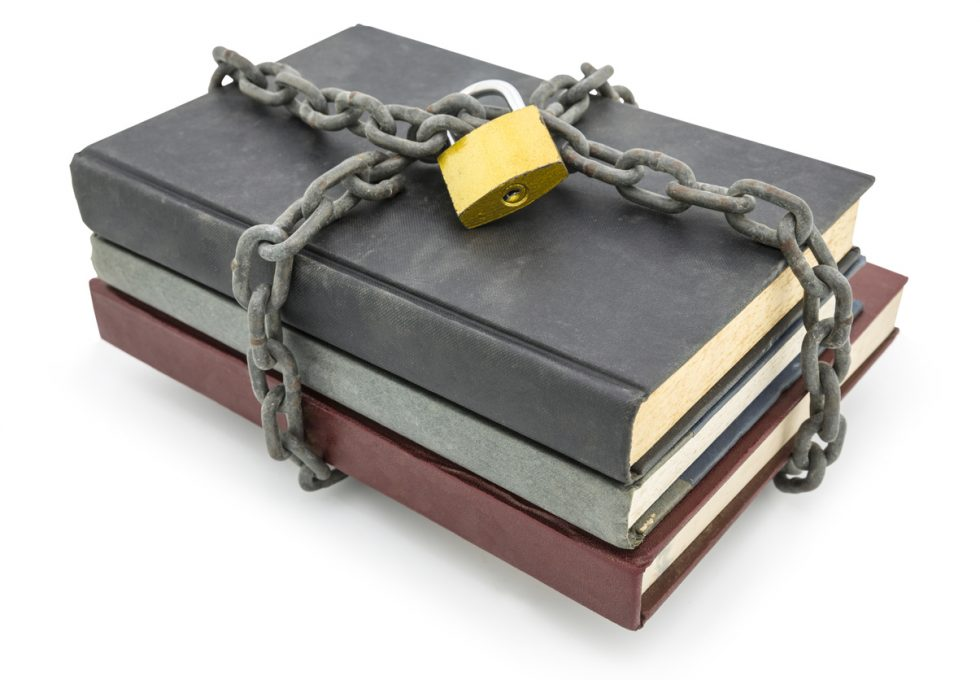 Top secret information concept, old books with chain and padlock isolated on white background